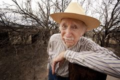 Rancher with sad eyes. Elderly rancher with sad eyes in a straw hat Stock Images