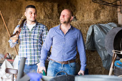 Ranchers working in a granary Stock Photos