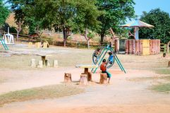 Unidentified local little boys are playing in a village park. royalty free stock images