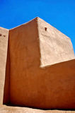 Rancho de Taos Church Wall. This is a picture of the dramatic side wall of the famous adobe church, San Francisco de Assisi, in Rancho de Taos, New Mexico Royalty Free Stock Image