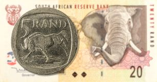 5 rand coin against 20 south african rand bank note obverse stock image