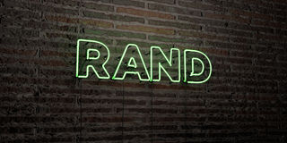 RAND -Realistic Neon Sign on Brick Wall background - 3D rendered royalty free stock image. Can be used for online banner ads and direct mailers Stock Images