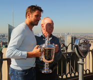 Rand Slam champions Stanislas Wawrinka (L) and tennis legend Rod Laver posing with US Open trophy Royalty Free Stock Photo