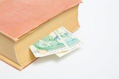 Rand sudafricano in libro isolato Immagine Stock