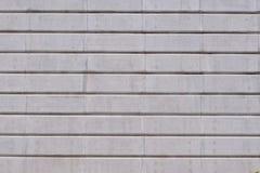 Randig betongvägg Arkivfoto