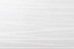 Randig mjuk bakgrund för vitabstrakt begrepptextur med lutning lutade ned remsor Arkivfoton
