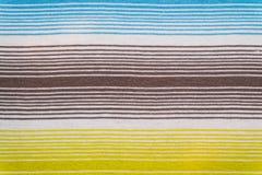 Randig tygmodell i mjuka pastellfärgade färger texturerad abstrakt bakgrund Arkivbilder