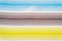Randig tygmodell i mjuka pastellfärgade färger texturerad abstrakt bakgrund Royaltyfri Bild