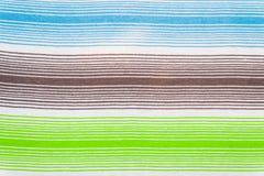 Randig tygmodell i mjuka pastellfärgade färger texturerad abstrakt bakgrund Arkivfoton