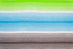 Randig tygmodell i mjuka pastellfärgade färger texturerad abstrakt bakgrund Arkivfoto