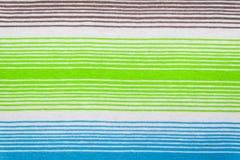 Randig tygmodell i mjuka pastellfärgade färger texturerad abstrakt bakgrund Fotografering för Bildbyråer