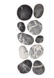 Randiga svartstenar på vit bakgrund Arkivbild