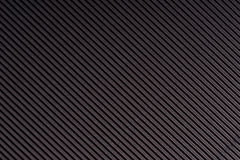 Randigt mörker - grå färg utföra i relief papper kulört papper Svart texturbakgrund Royaltyfri Foto