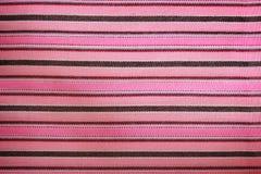 Randigt rosa tyg för bakgrund Textur mönstrar material Royaltyfria Bilder