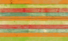 Randigt trä texturerar kulört Royaltyfri Bild