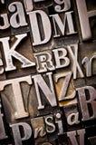 Random Alphabet. A randon arrangement of letterpress letters. Part of a series of letterpress backgrounds stock image