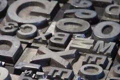Random arrangement of letterpress lead letters Stock Photo