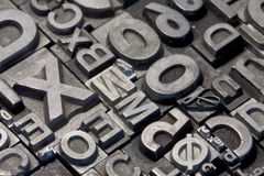 Random arrangement of letterpress lead letters Stock Photography