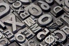 Random arrangement of letterpress lead letters Stock Photography