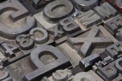 Random arrangement of letterpress lead letters Royalty Free Stock Images