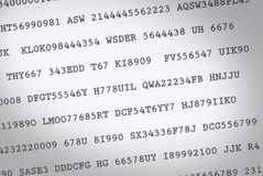 Random codes. Random code printed on white paper. Shot from above stock photography
