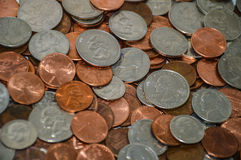Random coins. From the United States including pennies, nickles, dimes and quarters stock photography