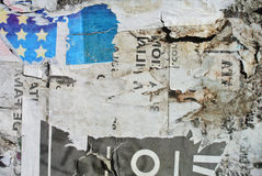 Random collage texture paper on eroded wall resembling a flag Stock Images