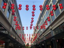 Hanging lanterns deco in the street stock image