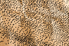 Random dots. All over brown paper for background stock photography