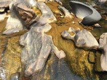 Random formation of stones by the water stock image