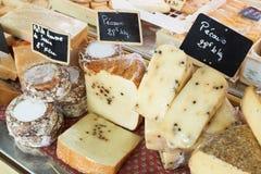 Random French cheese on Provence market stock photos