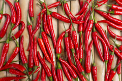 Random fresh red chili. On bamboo wood background Royalty Free Stock Photos