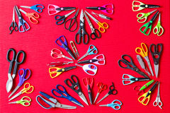 Random groups of multiple scissors conceptualy laid on red Royalty Free Stock Image