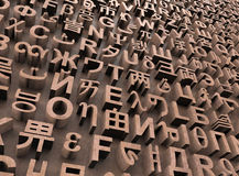 Random letters from many languages stock photos