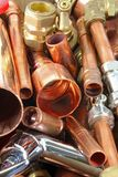 Plumber`s pipes and fittings Stock Images