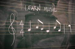 Random music notes written on a blackboard. Learn or teach music concepts