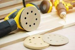 Free Random Orbit Sanders, Sanding Machine Tool On Walnut Plywood In Workshop, Woodworking Handicraft And Diy Concept .selective Focus Royalty Free Stock Photography - 191149497