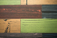Random pattern of colourful tile with wood on surface Stock Images
