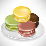 Random pile of macaroons on plate Stock Image
