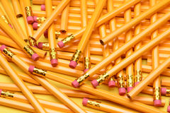 A Random Pile of Pencils. Brand new pencils scattered on a yellow surface. Great for back to school projects stock photography