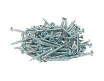 Random pile of round threaded steel screw Royalty Free Stock Image