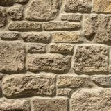 Random rubble stone wall background. Close up image of a new panel of stone walling Stock Images