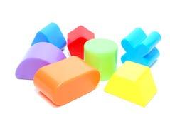 Random Shape Toys. Random Plastic Geometric Figures Children Toys Isolated on White Royalty Free Stock Photo