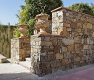 Random Stone Wall Stone plant pots Stock Images