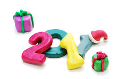 Random Text 2011 with Gifts. 3D New Year Text 2011 Laying Random with Gifts Made of Colored Plasticine Isolated on White Background Stock Image