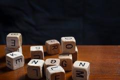 Random wooden letter dices. Dyslexia concept stock photography