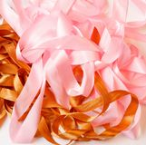 Randomly lying pink and brown ribbons. Close-upe, top view Stock Photo