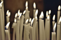Randomly placed firing candles Royalty Free Stock Photos