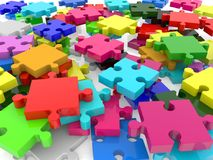Randomly stacked puzzle in various colors Stock Images