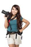 Randonneur féminin partant en vacances avec le sac à dos et l'appareil-photo Photo libre de droits